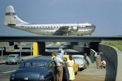 A Boeing Stratocruiser on the taxiway overpass at Idlewild Airport
